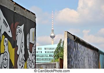 the Berlin Wall - a gap in the Berlin Wall and the...
