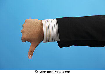 Businessman\\\'s hand with thumb down