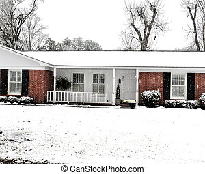 Ranch House  - A ranch house covered with falling snow.