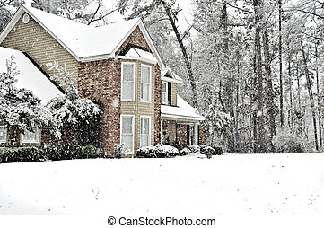 Snow Day - Executive home covered with a white snow blanket...