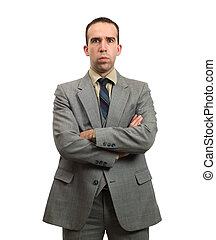 Stern Businessman - A young businessman with his arms...