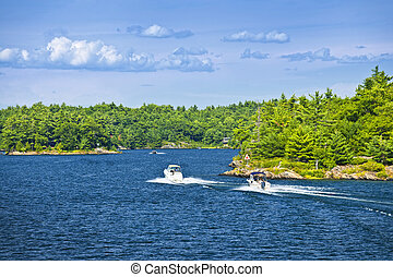 Boats on Georgian Bay - Recreational boats on blue waters of...