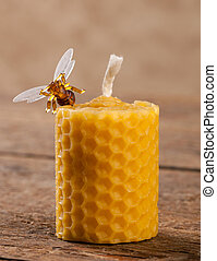Beeswax candles on wooden table
