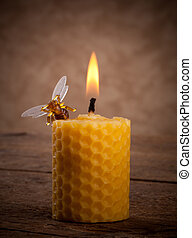Beeswax candles - Lighted beeswax candles on wooden table