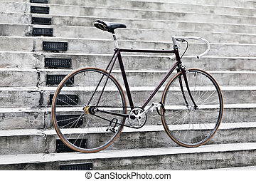City bicycle and concrete stairs, vintage style - City...