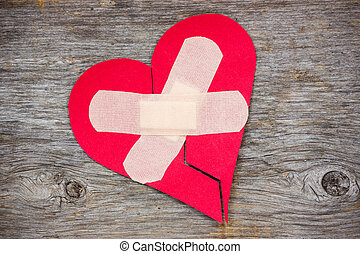 Broken heart on the wooden background - Broken heart with...