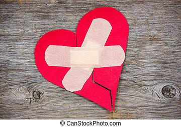 Broken heart on the wooden background - Broken heart with...