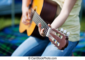 Girl Playing Guitar - Young girls hands playing guitar...