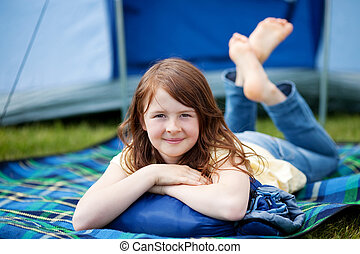 Girl Lying On Blanket With Tent In Background - Portrait of...