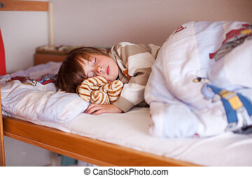 Boy Sleeping On Bunk Bed - Cute little boy sleeping on bunk...