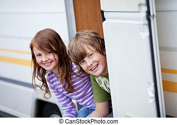 Boy And Girl Sitting At Caravan Entrance - Portrait of...