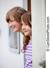 Sibling Looking Away While At Doorway Of RV - Young brother...