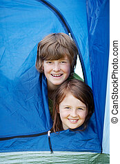 Brother And Sister Lying In Tent - Portrait of young brother...