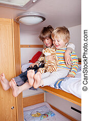 Two happy Boys In A Caravan - Two happy little boys in a...