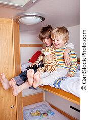 Two happy Boys In A Caravan - Two happy little boys in a...