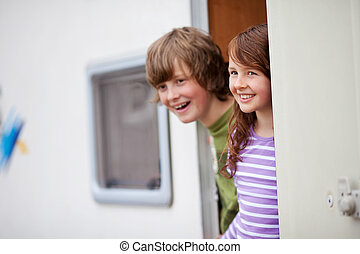 Kids Looking Away At Caravan Entrance - Two Kids looking...