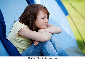 Girl Looking Away While Sitting In Tent - Thoughtful little...