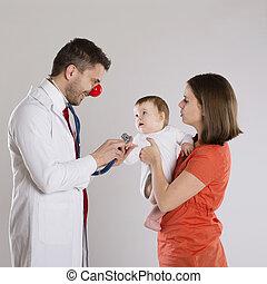 Pediatrician doctor - Mother with baby are having a medical...