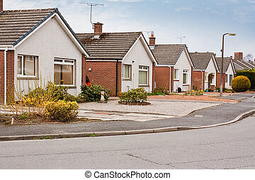 suburban bungalows on housing estate - row of modern...
