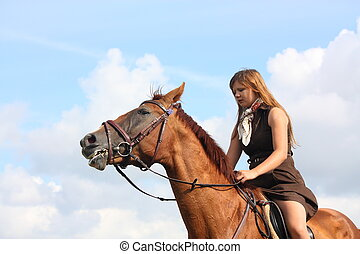 Girl and horse portrait on sky background on sunny day
