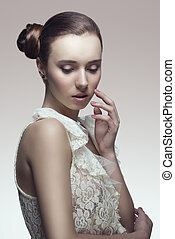 elegant woman with later chignon - elegant fashion brunette...