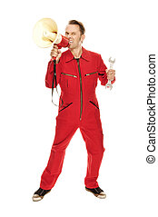 Mechanic in red Overall screaming into a megaphone, isolated...