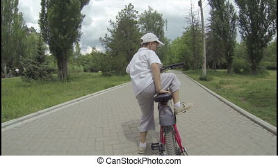 Boy begins to go by a bicycle