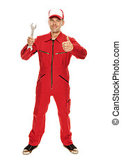Mechanic in red Overall - holding a wrench and doing a...