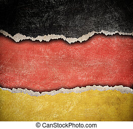 Grunge ripped paper German flag pattern