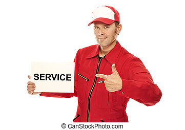 Mechanic in red Overall pointing to a sign with Service on...