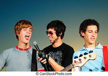 Young musical band - Portrait of three young musicians...