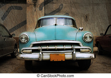 Grunge oldtimer - Front view of vintage classic american car...