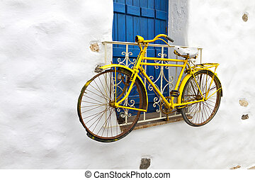 Traditional house in Greece - Decorative bicycle hanging...