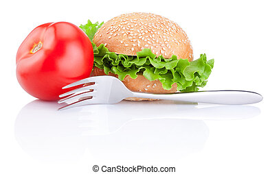 Sandwich bun with lettuce, juicy red tomato and fork,...