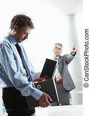 Fired Office Worker - Boss dismissing an employee. Dejected...