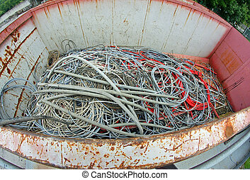 container full of copper electrical cables in a municipal landfill