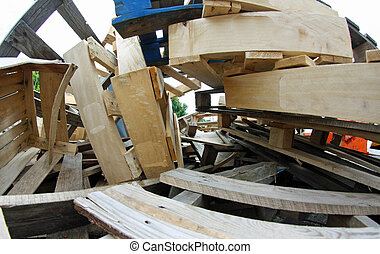 dump with many wooden pallets piled up