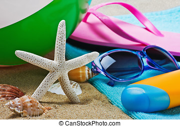 sunblock and stuff for the beach. Focus on starfish