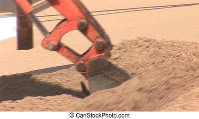tracked excavator digging sand