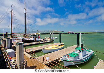 Boats docked at Fishermans Wharf in San Francisco - Alcatraz...