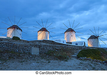 Mykonos island in Greece by night - The famous Windmills of...