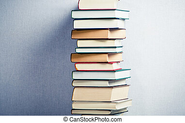 Very high stack of books in the middle