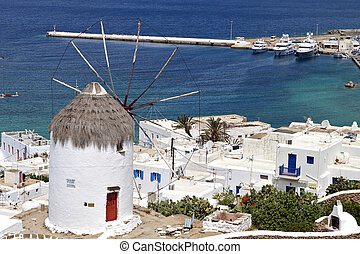 Mykonos island in Greece - Traditional windmill over the...