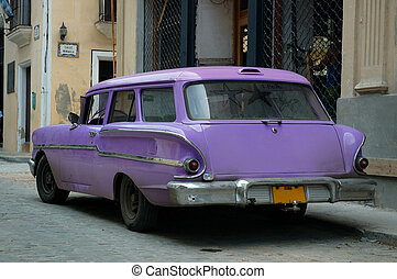 Vintage tropical car - Tropical oldtimer parked in the...