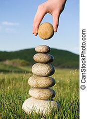 equilibrium - Summer Someones hand constructs equilibrium on...