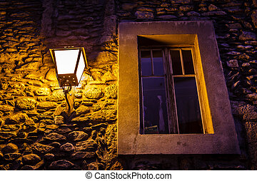Window Illuminated By Street Lamp in Megeve, French Alps