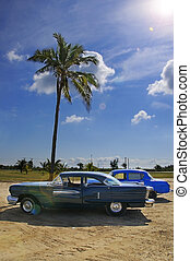 Tropical oldtimer - Vintage classic american car parked...