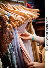 Rack of dresses at market - Recession bargains: rack of...