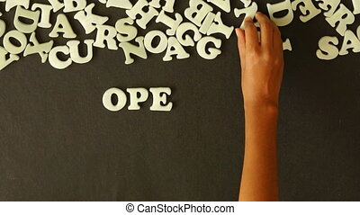 Open Your Mind - A person spelling open your mind with...