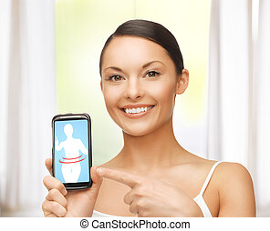 woman pointing at smartphone with application - beautiful...